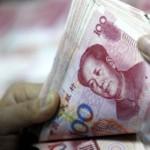 Китай знову девальвував юань